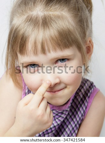 Little girl touching her nose - closeup portrait
