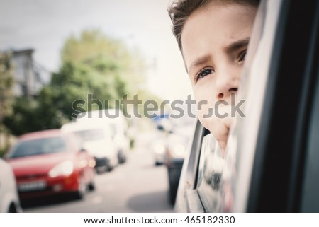 Little girl travel by car.