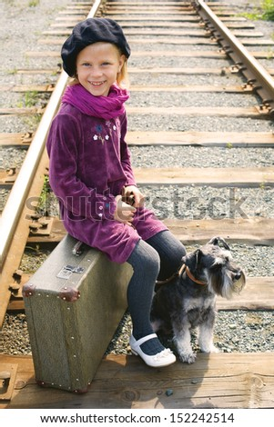 little girl traveling with a dog - stock photo
