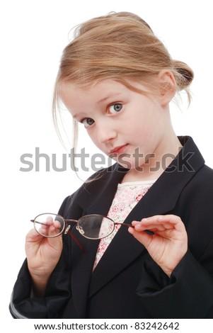 Little girl trying on glasses - stock photo