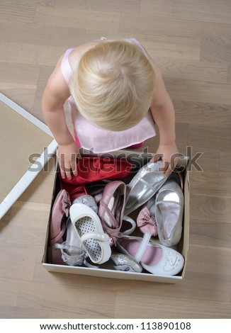 little girl trying on shoes - stock photo