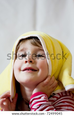 Little girl under blanket