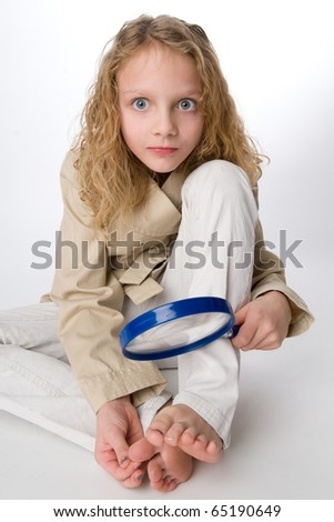 Little girl using a magnifying glass