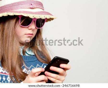 Little girl using phone - stock photo