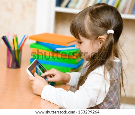 little girl using tablet computer - stock photo
