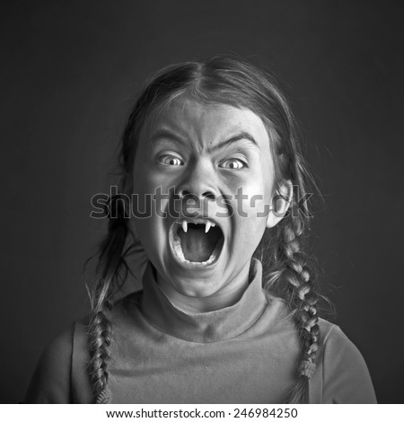 Little girl vampire on black white background - stock photo