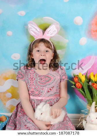 little girl very excited for easter - stock photo