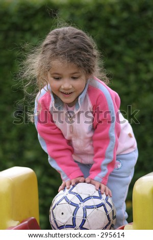 little girl walking with a ball 3