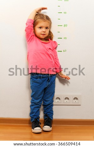 Little girl wants to grow up fast as she can - stock photo