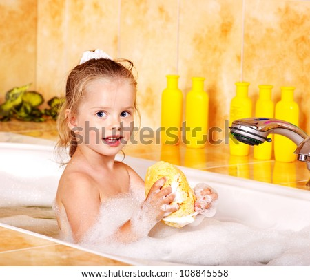 Little girl washing in bubble bath . - stock photo