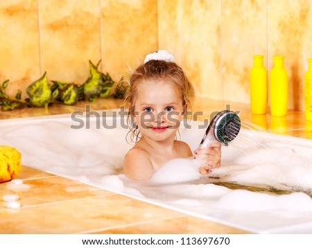 Little girl washing in bubble bath . - stock photo