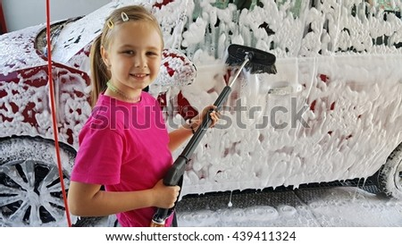 little girl washing the car