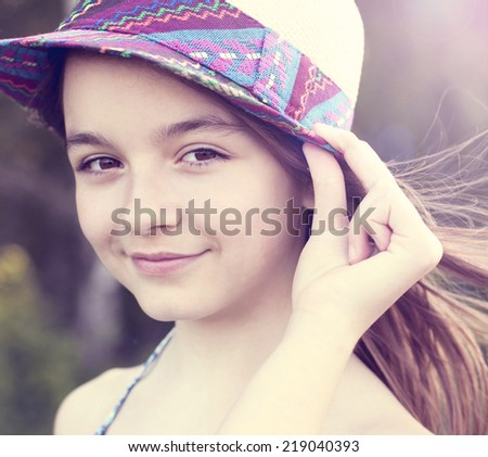 Little girl wearing a hat outdoors