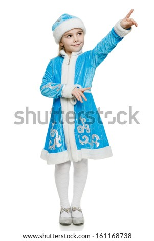 Little girl wearing blue suit of snow maiden standing in full length pointing to the side, over white background - stock photo