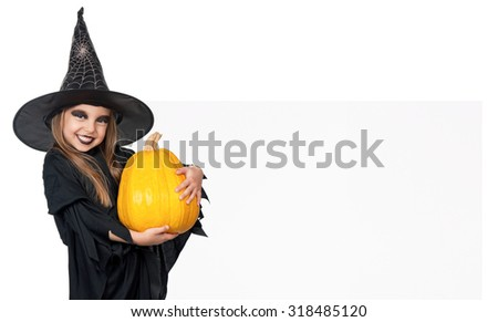 Little girl wearing halloween costume with pumpkin and blank board on white background - stock photo