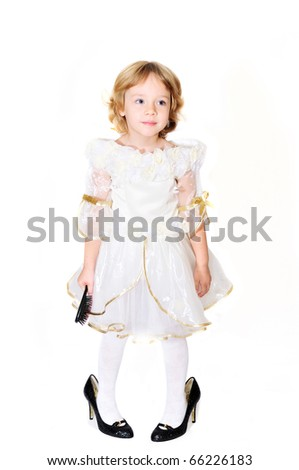 little girl wearing like a princess but with mother's shoes
