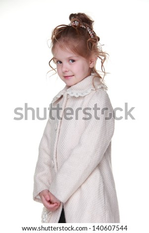 Little girl wearing stylish coat on Beauty and Fashion theme