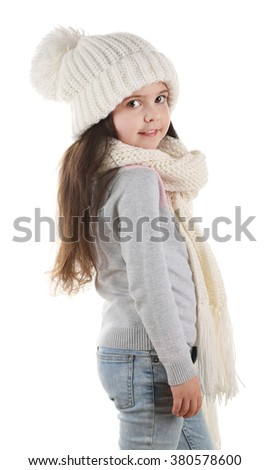 Little girl wearing trendy knitted clothes, isolated on white