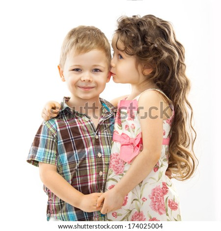 Little girl whispering something to boy and holding his hands. Love concept. Isolated on white background - stock photo