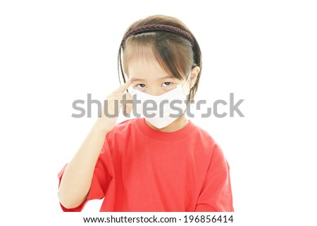 Little girl with a bad cold - stock photo