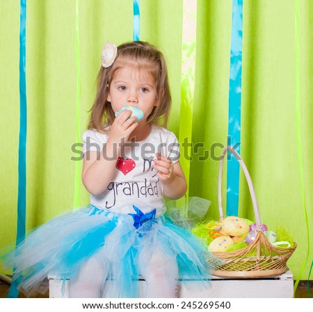 Little girl with a basket with Easter eggs - stock photo