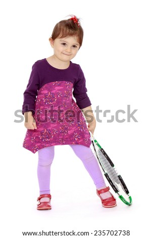 little girl with a big tennis racket.White background, isolated photo. - stock photo