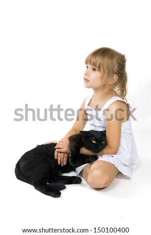 little girl with a black cat (child and pet) - stock photo