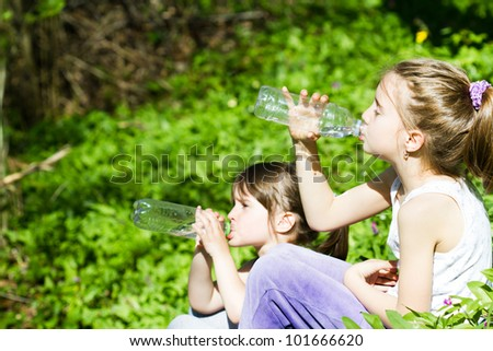 little girl with a bottle of water