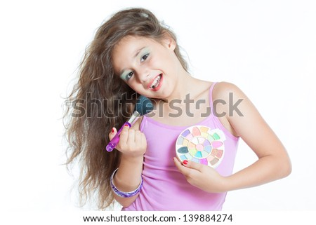 little girl with a brush for makeup isolated on white - stock photo
