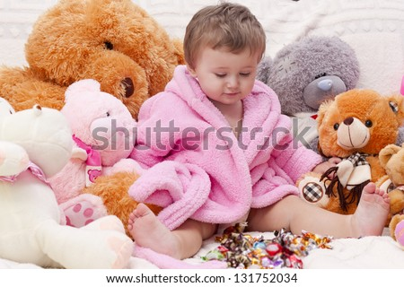 Little girl with a bunch of toys