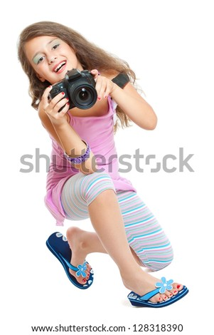 Little girl with a camera - stock photo