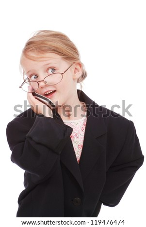 Little girl with a cell phone - stock photo