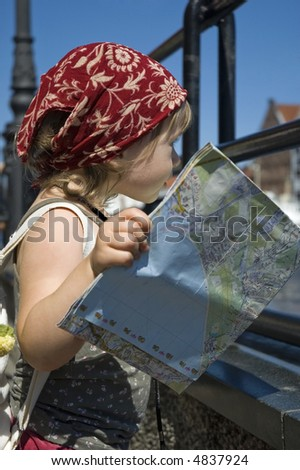 little girl with a city map. Gdansk. Poland - stock photo