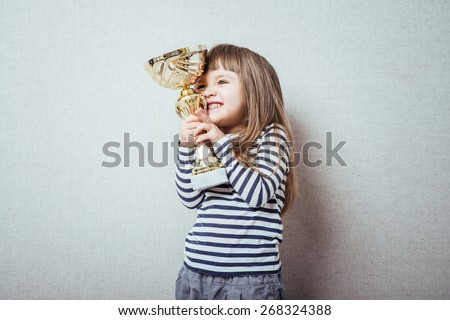 little girl with a cup - stock photo