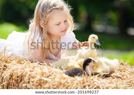 little girl with a duckling