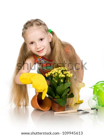 little girl with a flower on a white background