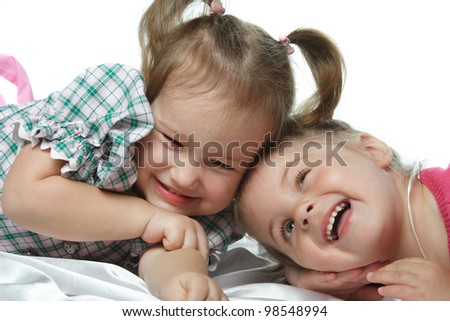 little girl with a happy laugh on a white background - stock photo