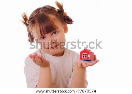 Little girl with a key and a house in her hands - stock photo