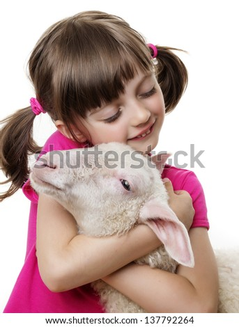 little girl with a lamb - stock photo