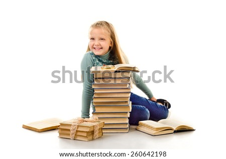 little girl with a lot of books isolated on a white background