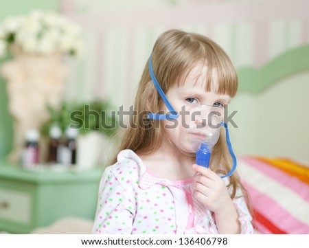 little girl with a mask for inhalations - stock photo