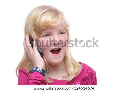 Little girl with a mobile phone - stock photo