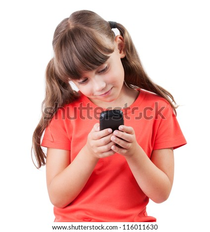 Little girl with a mobile phone on white background - stock photo