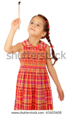 Little girl with a paintbrush, front view, isolated on white