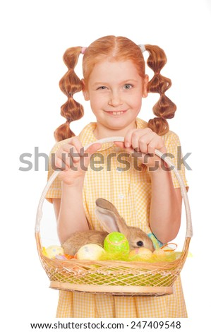 Little girl with a  rabbit in a basket easter eggs - stock photo