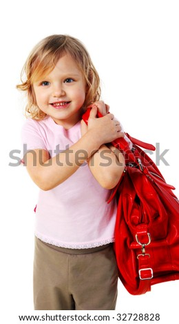 Little girl with a red bag on a white background. (isolated)