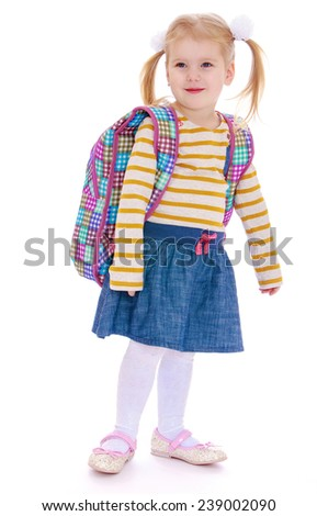 little girl with a satchel on his shoulders. Studio photo, isolated on white background. - stock photo