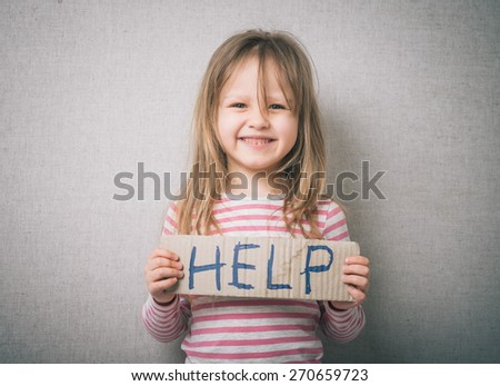 little girl with a sign HELP