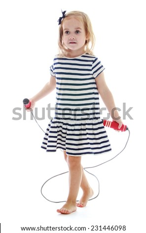 Little girl with a skipping rope in his hands.Isolated on white background. - stock photo
