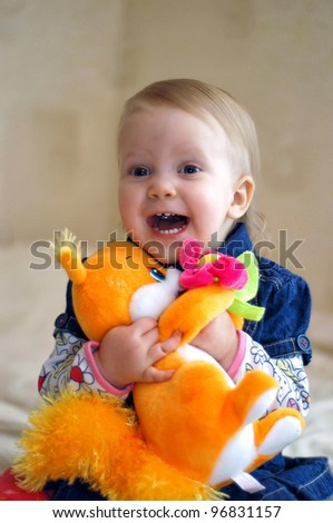 little girl with a toy
